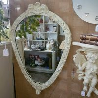 Pear shaped ornate mirror